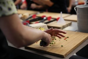 Image of chopping Chilli's during a Cookery Class at Food Sorcery Didsbury