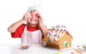 Image of child making a gingerbread house at Food sorcery Cookery School Didsbury