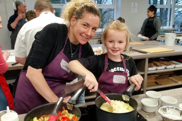 Image of Big & Little Cooks cooking together at Food Sorcery Didsbury Manchester