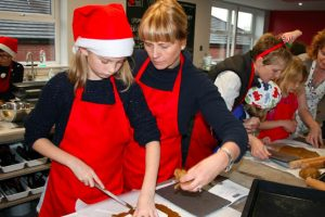 imge of big and little cooks at christmas at cookery school didsbury