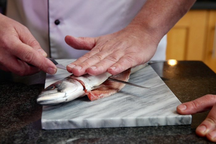 Image of chef preparing fish at Food Sorcery Cookery School Didsbury