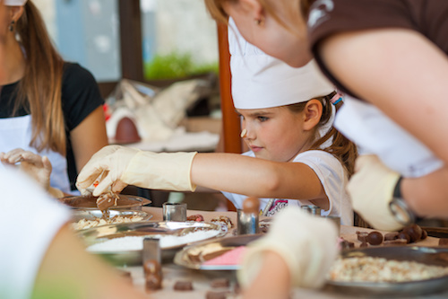 image of young girl making chocolate sweets at Food Sorcery Cookery School Didsbury Manchester Kids Cookery chocolate party