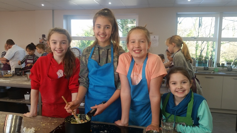 Image of Girls at Cookery Holiday club at Food Sorcery Cookery School, Didsbury, Manchester.