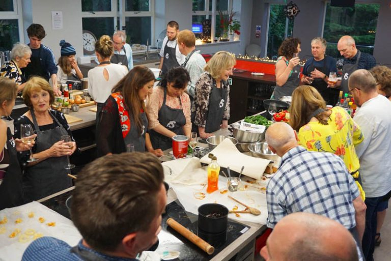image of Cooking Together overhead at Food Sorcery private dining for 24 people Didsbury Manchester