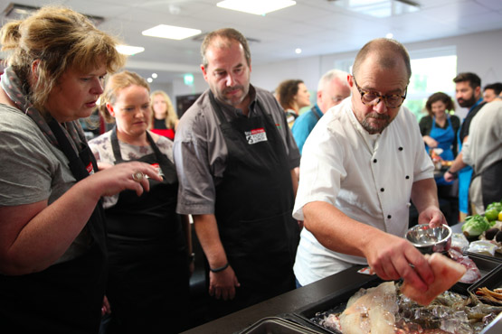 Image of team building event at food Sorcery chosing fish masterclass