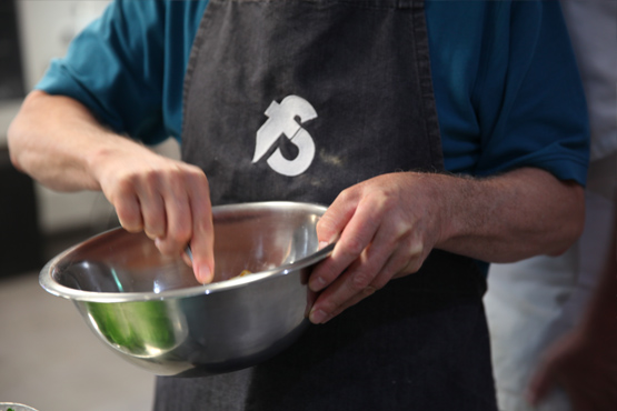 image of mixing at the team building event at the cookery school Manchester