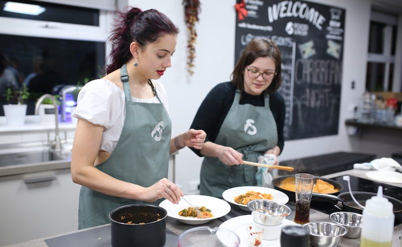 image of cooking together caribbean recipes cookery class at Food Sorcery Didsbury Manchester vegan and Vegetarian options available