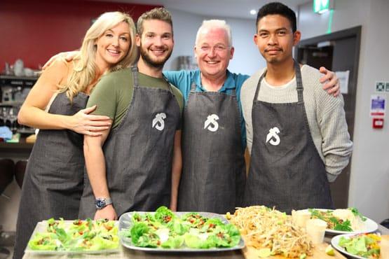image of team building grey aprons at Food Sorcery Didsbury Manchester team bonding fun