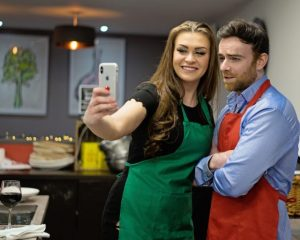 image of couple taking a selfie at cookery Class Food Sorcery Vegan diet