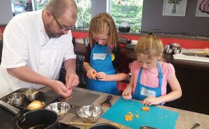 image of choppoing carrots at Food Sorcery kids cookery camp Didsbury Manchester