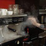 image of steam astoria coffee machine with barista Gavin at Coffee Loves Class in Didsbury Manchester