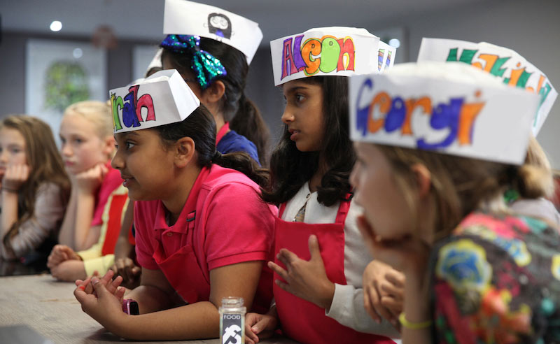 image of kids at cookery camp Didsbury, things to do in the holidays