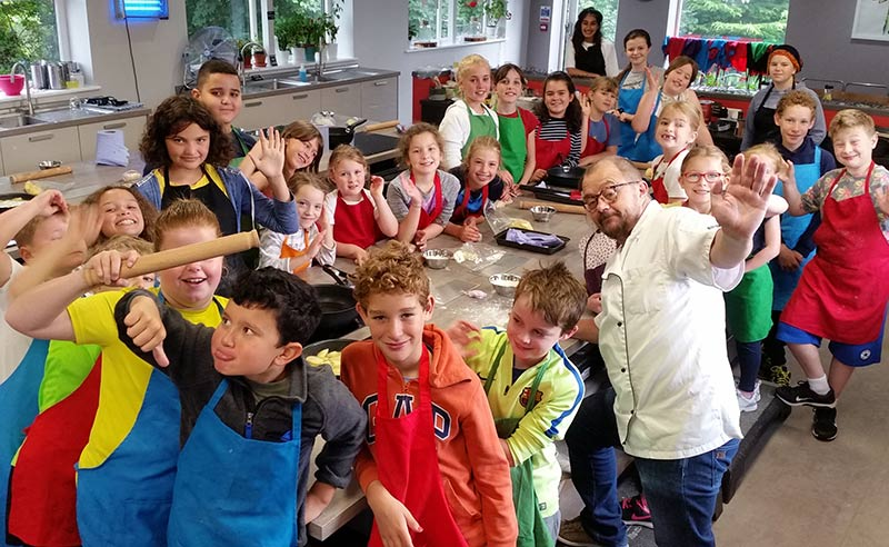image of kids at Food Sorcery holiday cookery camp in Didsbury Manchester