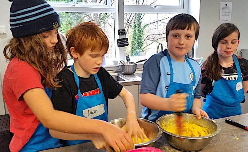 image of kids helping make pastry at kids camp in Didsbury Manchester
