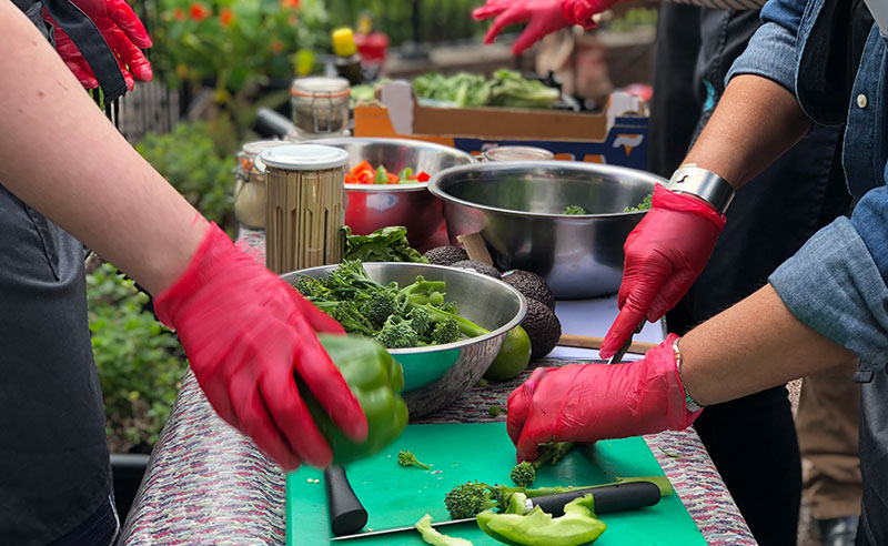 image of people making peanut and broccoli salad at Food Sorcery Manchester cookery school