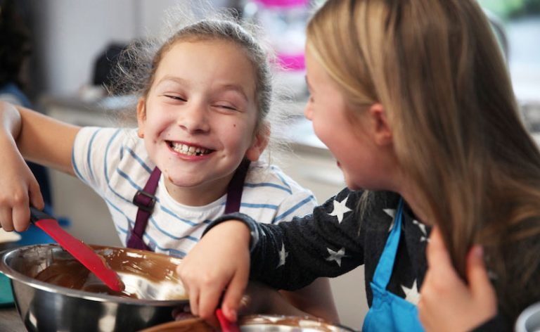 image of two girls smiling at cookery camp Didsbury