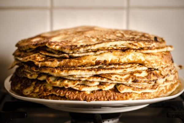 image of a stack of brown quinoa pancakes at Food Sorcery Didsbury