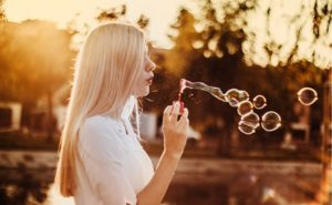 image of woman blowing bubbles at Food Sorcery
