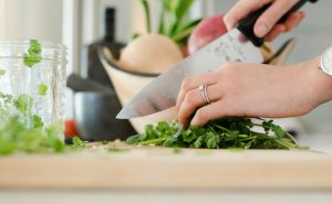 image of woman chopping coriander at Food Sorcery Didsbury