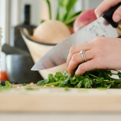 image of woman chopping coriander at Food Sorcery Didsbury