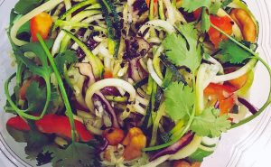 image of clean cooking healthy eating pad thai with courgette noodles cooked at food sorcery vegan clean eating