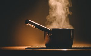 Image of backlit steaming deep pan at Food Sorcery Didsbury