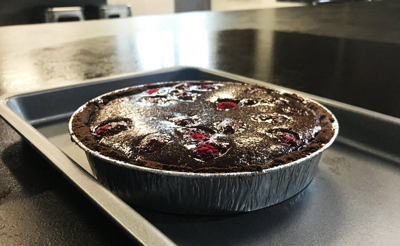 Image of baked raspberry and chocolate tart with Sandy Docherty at Food Sorcery Didsbury