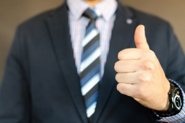 Image of man in suit with thumbs up