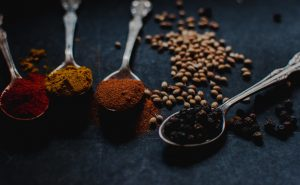 Image of spices and seasonings on silver teaspoons at Food Sorcery Didsbury