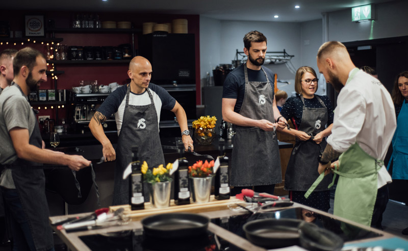 Image of Fit Food Class and chef putting aprons on at Food Sorcery, Didsbury