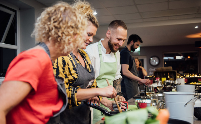 Image of Fit Food Class Chef Jan Cron smiling with class whilst cooking at Food Sorcery, Didsbury