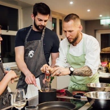Image of Jan Cron adding Tabasco to Fit Food class dish at Food Sorcery, Didsbury