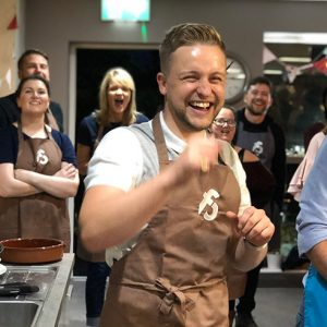 image of Lookers Team Build at Food Sorcery brown apron and laughing with the team