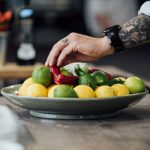 Image of fit Food Class chef reaching for limes in a bowl