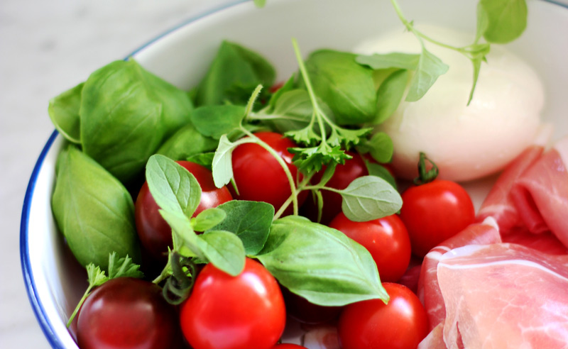 Image of fresh cherry tomatoes, mozzarella and basil at Food Sorcery, Didsbury