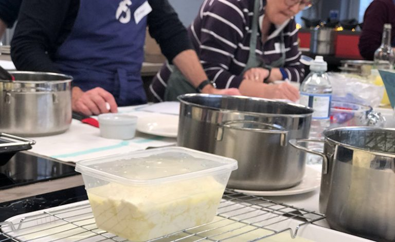 image of cheese making class with Master of Cheese Louise Talbot writing notes