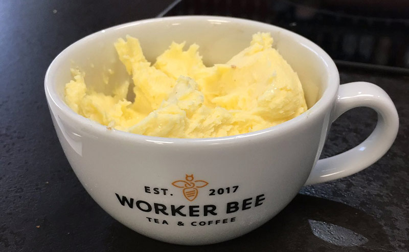 image of home made butter in worker been manchester coffee cup at food Sorcery