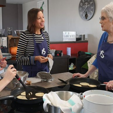 image of people cooking at cookery class in the cookery school vegan and vegetarian