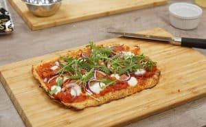 Muscle Gain Fit Food Class Cauliflower Pizza on chopping board At Food Sorcery Didsbury