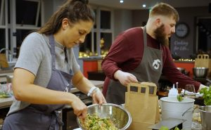 Image of Muscle Gain Fit Food Class participants making Freekeh Tabbouleh