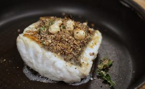 Image of Muscle Gain Fit Food Class macadamia-crusted cod cooking in pan