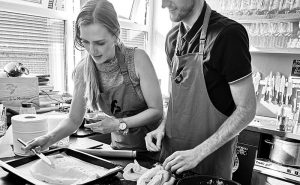 image of couple at fish cookery class Didsbury Manchester