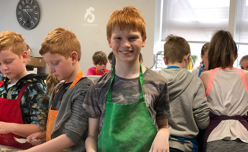 image of child at kids cookery camp cookery school manchester