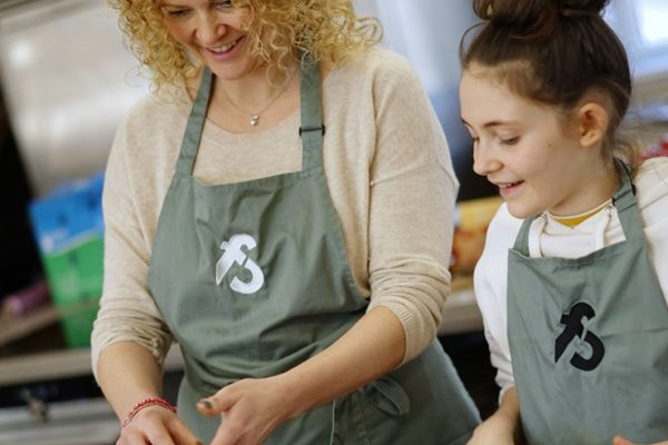 image of mother and child cooking together at Food Sorcery cooker school in Didsbury