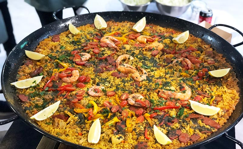 image of large paella cookery class at food sorcery cookery school manchester