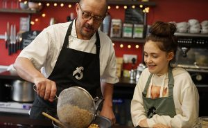 image of chef and child cooking together at Big little cooks at Food Sorcery cookery school Didsbury Manchester