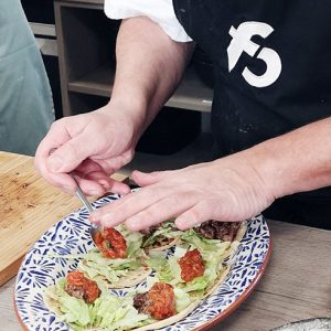 image of chef plating up at food photography and stying class at cookery school