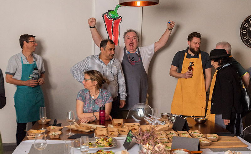 image of happy man group cooking prevent breast cancer masterchef invention test