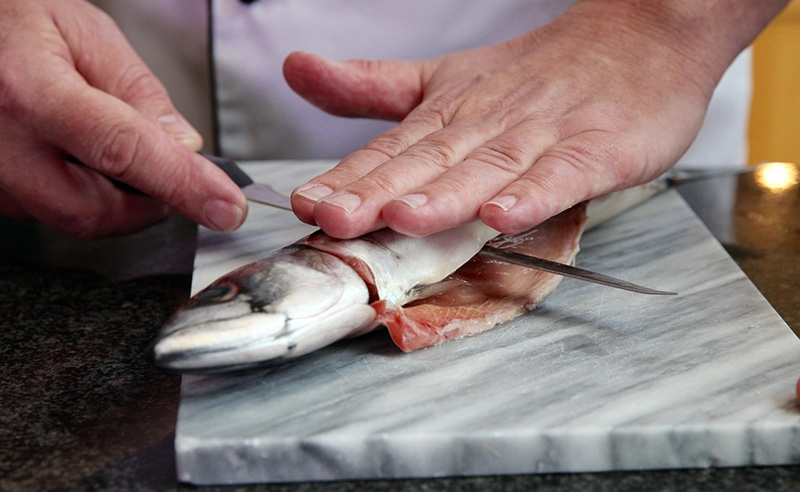 image of filleting macarel at food sorcery cookery school class didsbury