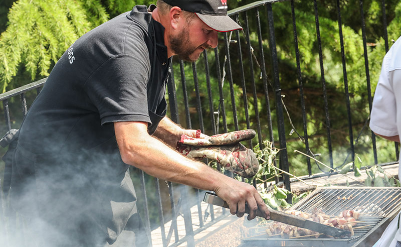 image of Jamie from seasoned logs cooking on the bbq cookery class